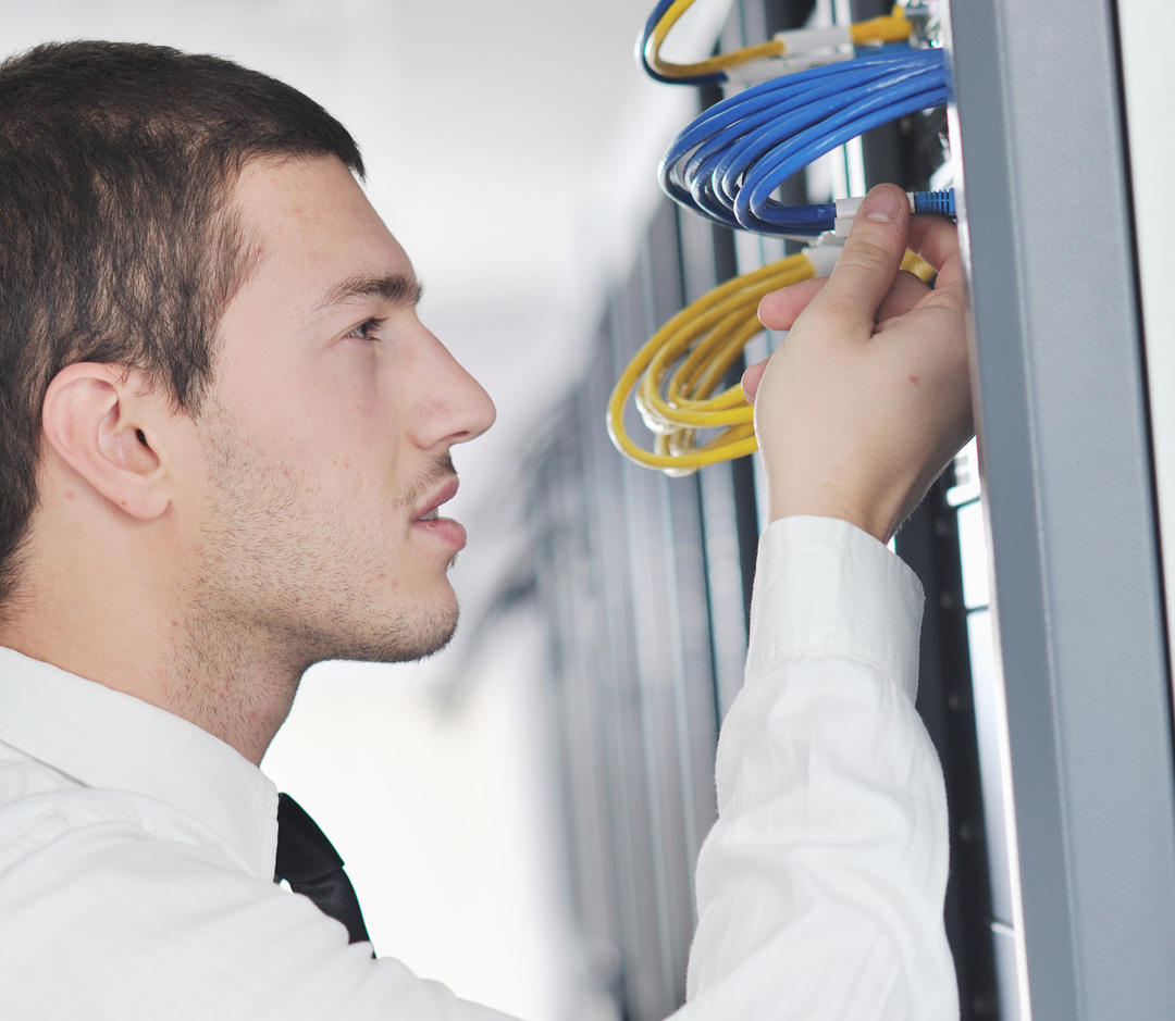 Managed IT Service technician doing network cabling.