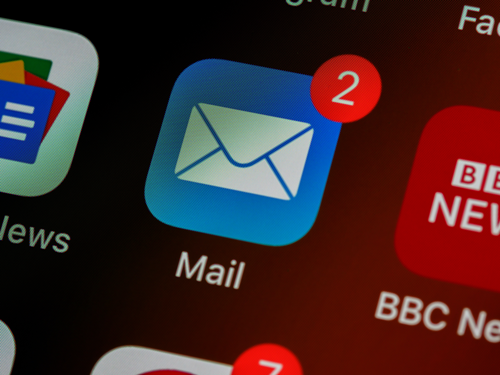 iPhone Mail app with two notifications. Email scams are a common tactic used by scammers.