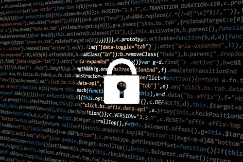 A lock in front of the background of code. Find out what ransomware is and how to prevent it.