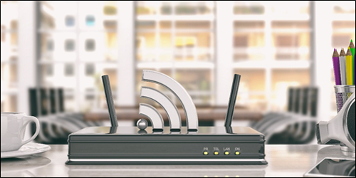 Router in an office with a Wi-Fi signal coming out. Learn how to improve your Wi-Fi and make your Internet faster.