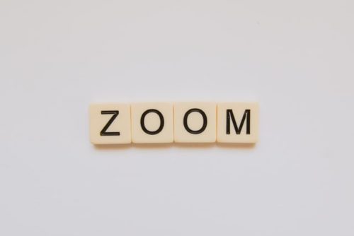 """""""Zoom"""" spelt in tiles against a white background. New features will combat disruptive participants."""