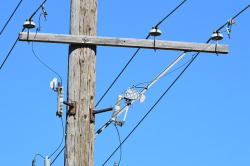 Utility pole against blue sky. The government promises to connect Canadians to high-speed Internet.