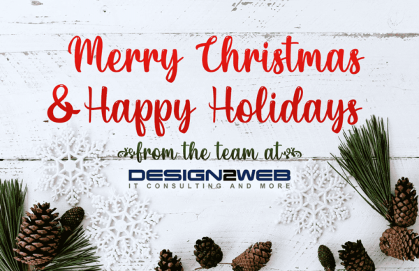 """White wooden panel with """"Merry Christmas & Happy Holidays from the team at Design2Web"""" amongst pinecones and snowflakes."""
