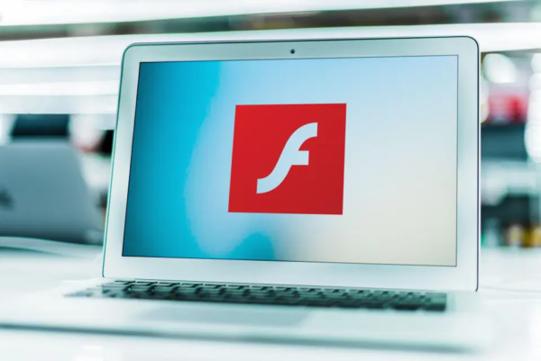 A laptop with the Adobe Flash Player logo on-screen.