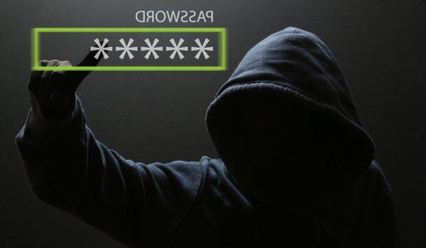 Hacker types in stolen password.