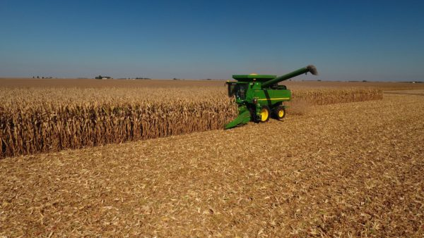 Farm equipment working in a field. Your agricultural business needs managed IT services.