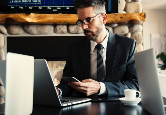 A lawyer sitting at a desk on his laptop. Your law firm needs managed IT services.