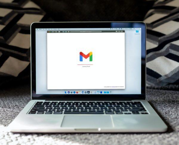A Macbook loading Gmail on Safari