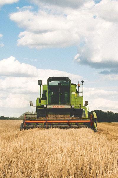 Farm vehicle working in field.