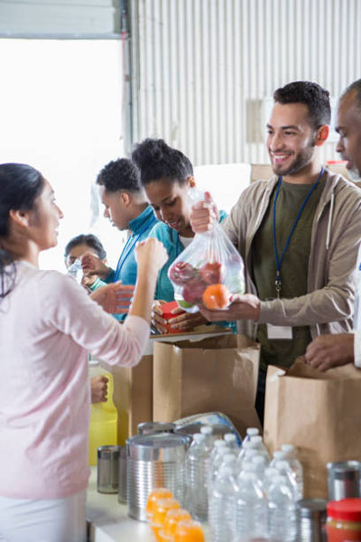 Group of food bank volunteers accept and organize donations.