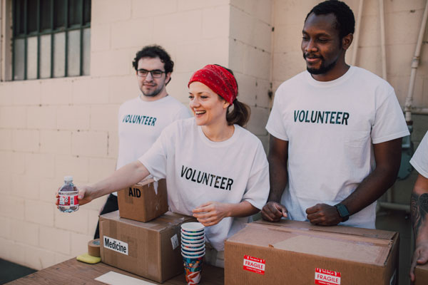 Volunteers handing out water. Canadian charities struggling with digital transformation